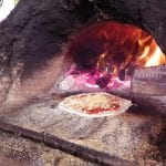 Earth oven pizza.